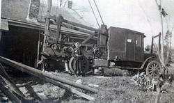 Mrs. Levi Dobson with well-drilling equipment
