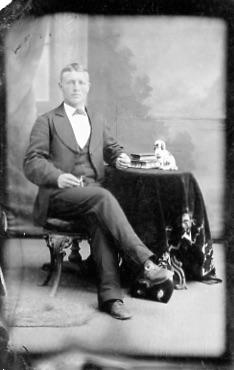 Tin photograph - unidentified man posing with a table